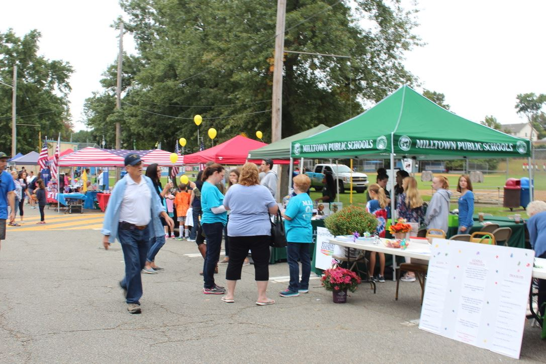 Milltown Day 2018 Photo of vendor tables and event participants walking around